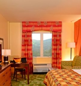 A bright, spacious room with a window overlook of the valley.