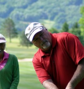 A happy couple enjoys a round of golf together.