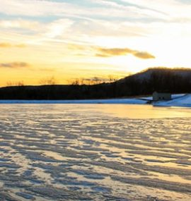 A frozen pond, waiting for ice skaters. Photo Credit - Justin Harris