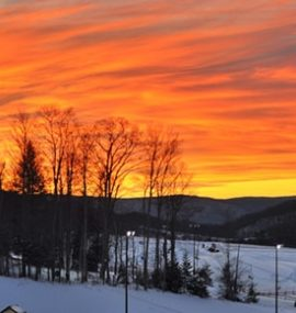A fiery sunset over the ski slopes.